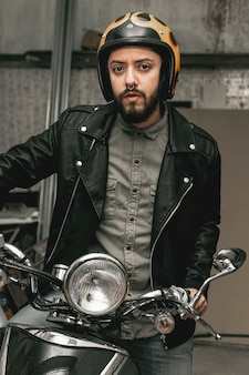 Man with leather jacket on motorcycle