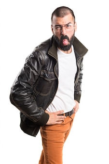 Man with leather jacket taking out his tongue