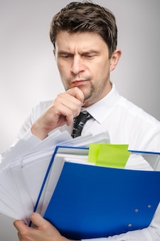 Man with lot of documents worker of the month with thinking face expression