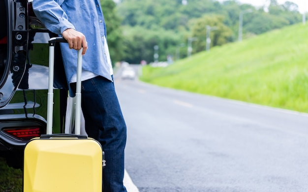 Man with luggage. travel solo and outdoor activities alone on summer holiday.
