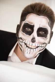 Man with make-up halloween. drawing a vampire, skeleton