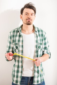 Man with measuring tape is standing