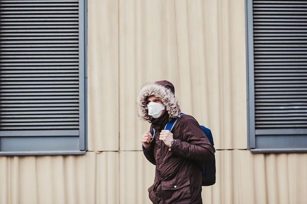 Man with medical face mask in street. novel coronavirus (2019-ncov)