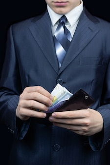 Man with money in his wallet
