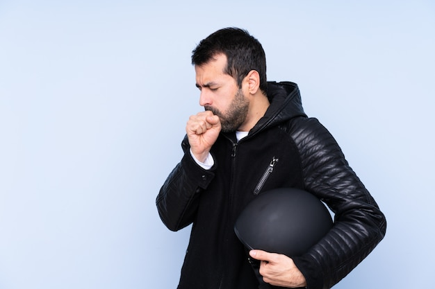Man with motorcycle helmet over isolated wall
