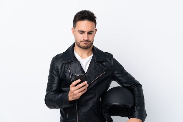 Man with a motorcycle helmet thinking and sending a message