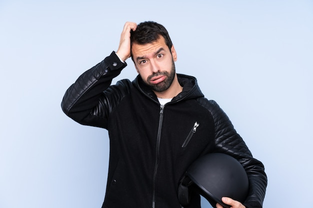 Man with a motorcycle helmet with an expression of frustration and not understanding