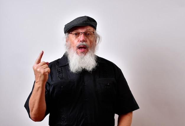 Man with an open mouth surprised pointing his finger up