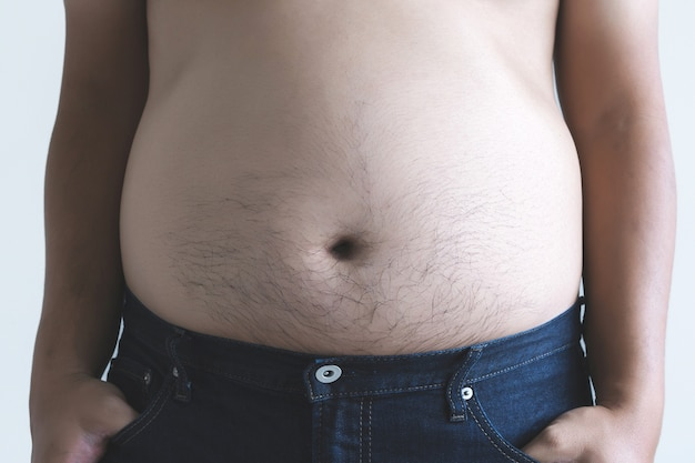 Man with overweight big fat belly chubby
