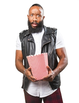 Man with a packet of popcorn