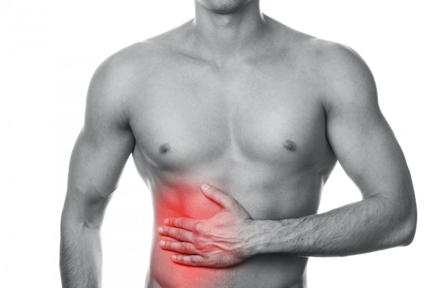 Man with pain in his stomach