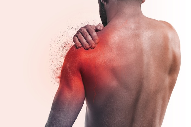 Man with pain in shoulder. concept of human pain