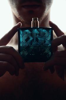 Man with perfume on white