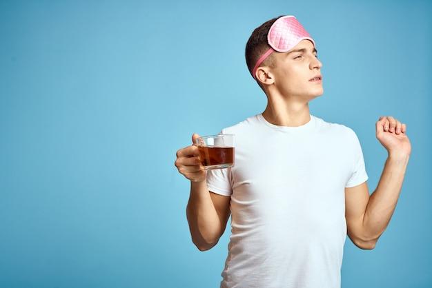 Man with pink sleeping mask