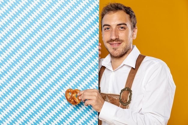 Man with pretzel and patterned sign