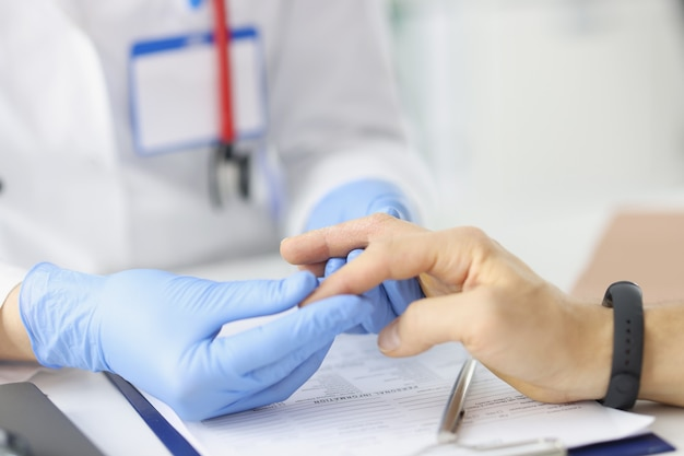 Man with problem of peeling skin on hands at doctor appointment hand skin diseases concep