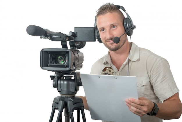 Man with professional camcorder isolated on white