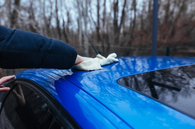 A man with a rag to dry the car. car wash concept