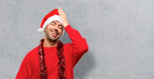 Man with red clothes celebrating the christmas holidays has just realized something