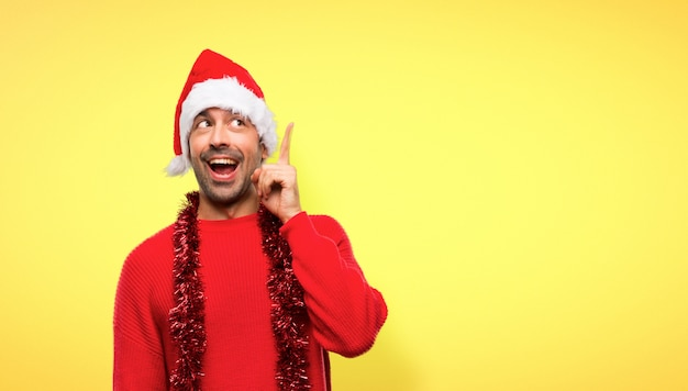 Man with red clothes celebrating the christmas holidays intending to realizes the solution
