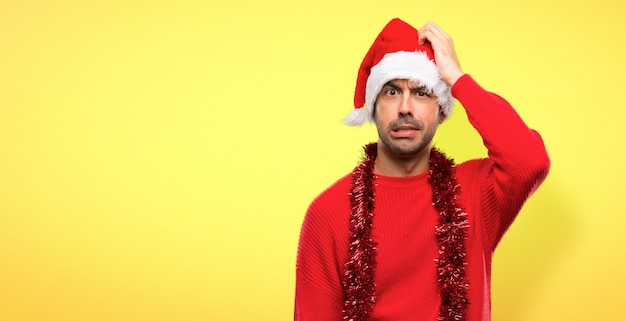 Man with red clothes celebrating the christmas holidays with an expression of frustration