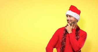 Man with red clothes celebrating the Christmas holidays looking to the side