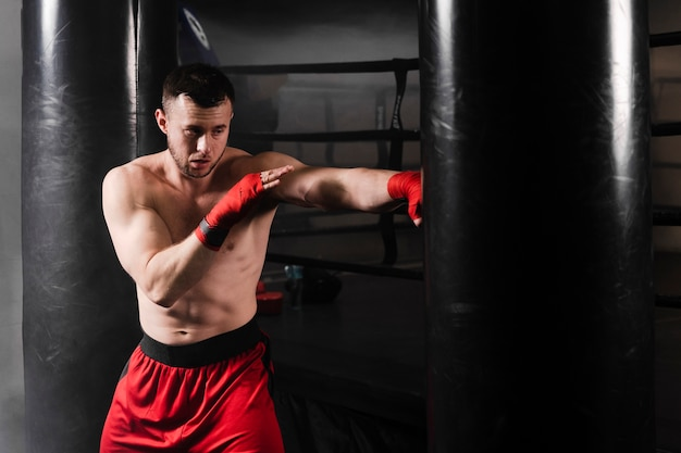 Man with red gloves boxing