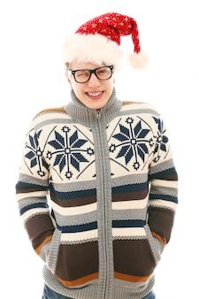 サンタの帽子を持つ男。クリスマスシーズン