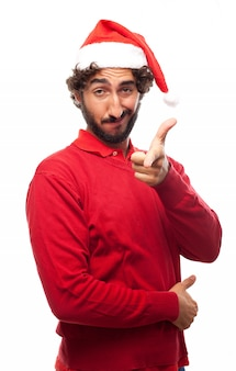 Man with santa's hat pointing