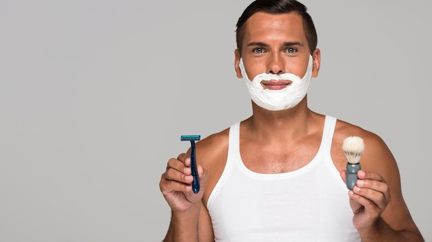 Man with shaving cream and copy-space