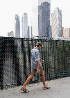 Man with shirt leaving somewhere in the city