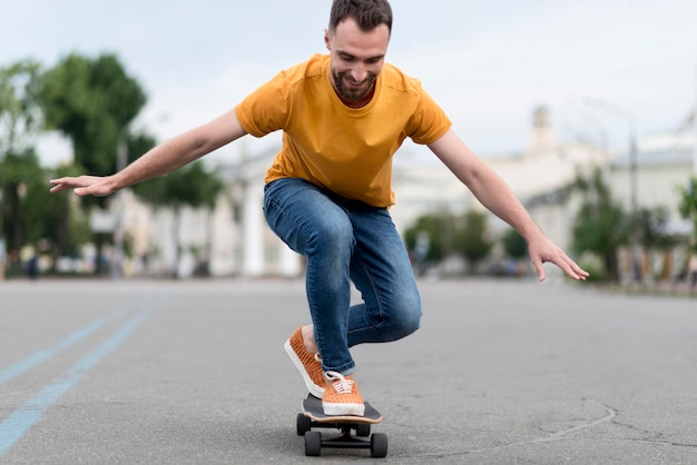 Man with skateboard front view
