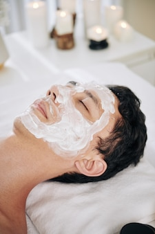 Man with soothing face mask