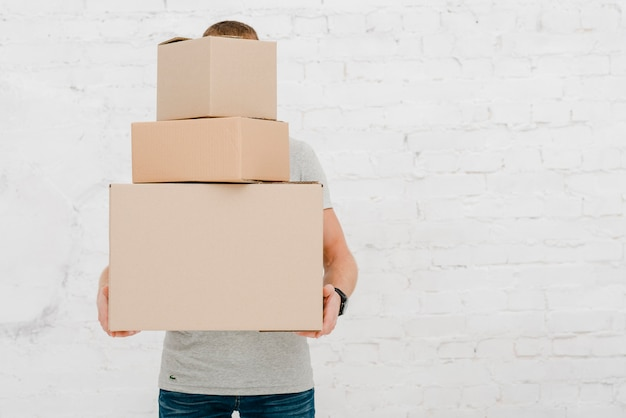Man with stack of boxes