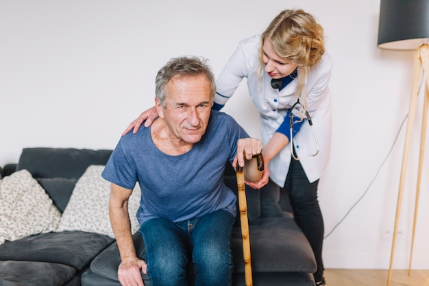 Man with stick in retirement home