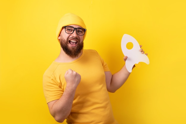 Man with successful startup over yellow background