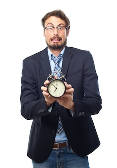 Man with suit holding an alarm clock