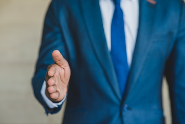 Man with suit reaching out hand