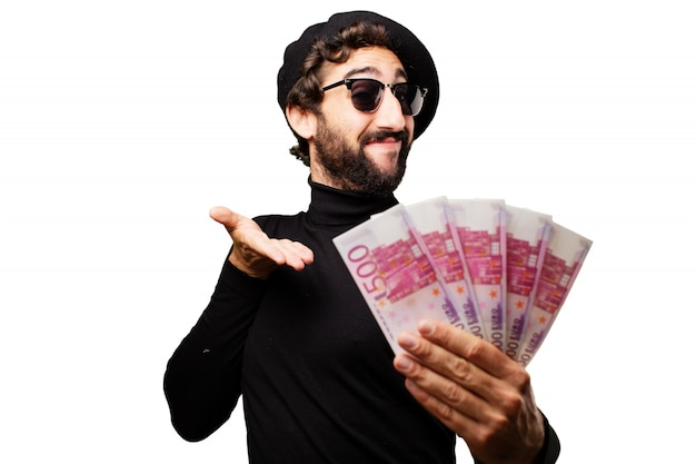 Man with sunglasses and beret pointing a hand full of banknotes
