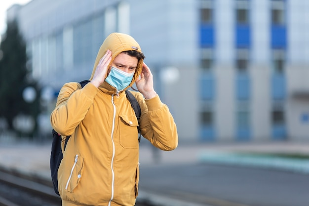 Man with surgical mask outdoor