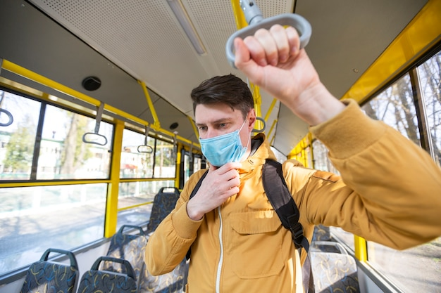Man with surgical mask in public transport
