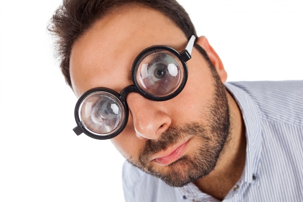 Man with a surprised expression and thick glasses