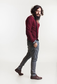 Man with suspenders and a long beard