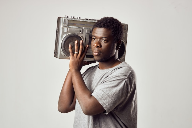 Man with a tape recorder in his hands listening to music african appearance lifestyle