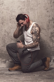 Man with tattoo listening to music