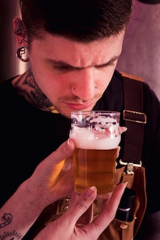 Man with tattoos producing craft beer