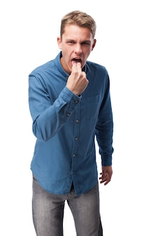Man with two fingers in mouth