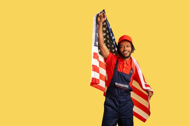Man with usa flag shouting and smiling celebrating labor day