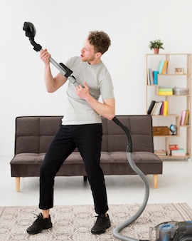 Man with vacuum cleaning