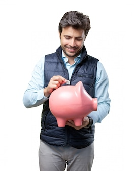 Man with vest insert coin on pig